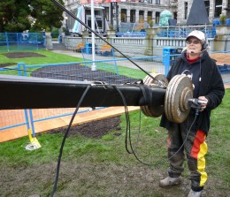 sometimes you have to work in the worst conditions, like here in the mud pit beside the stage during the 2010 Olympic Torch Run