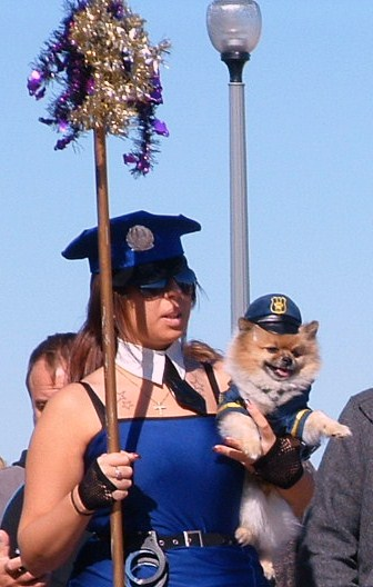 "In response to Mason Cooley's, ""Costumes tell a story"" here's a fairy tale about this picture: ""Curvaceous police woman falls in puppy love at the Sea Witch Festival in Rehoboth Beach and they live happily ever after."""