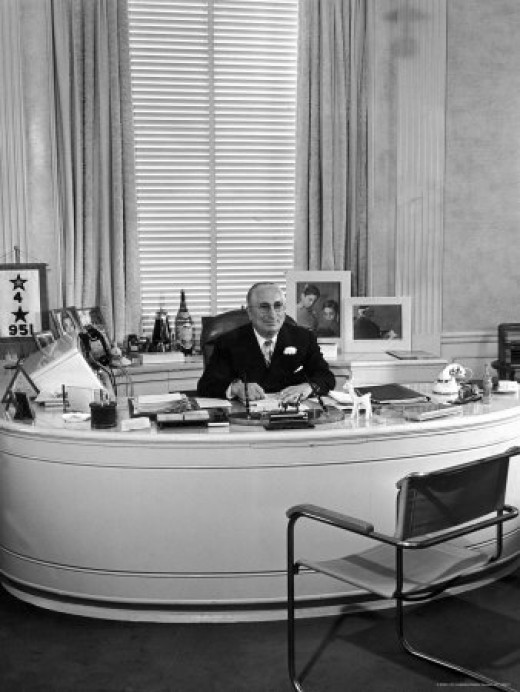 Louis B. Mayer, Sitting at His Office Desk, by Walter Sanders