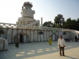 Author in front of the memorial constructed on the top of the first hill at Rajagriha, where Mahaveera gave his first talk