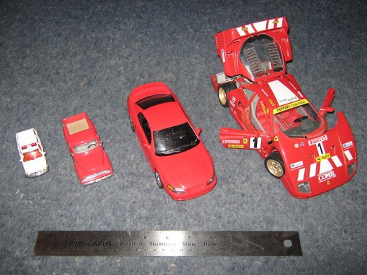 Different sizes of die-cast cars