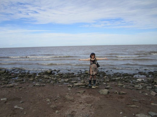 Poet on the beach in Argentina, looking for shells