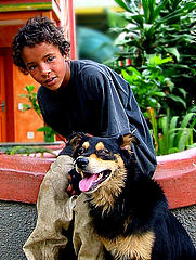 "A homeless ""street kid"" with his dog in Brazil      - carf/flikr"
