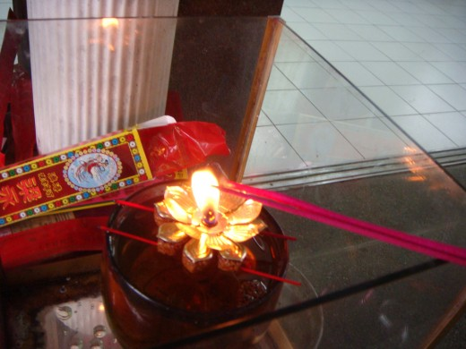 Lighting the incense for the dead