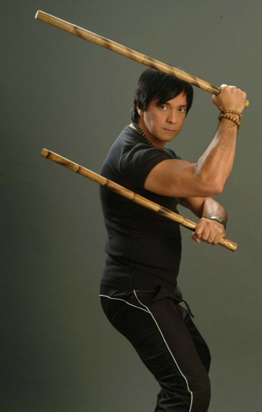 Filipino Actor Ronnie Rickets with Arnis in the movie Mano Mano