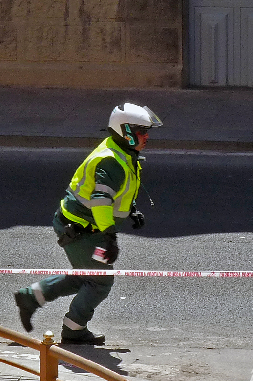 A Guardia officer checks that the road is closed properly