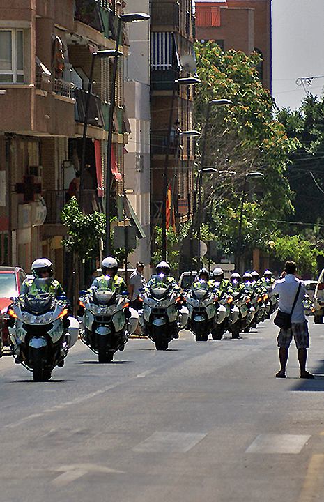 It is an hour before the race comes into Villa when all these Guardia come down this part of the race route.