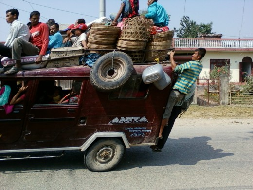 Painful Journey: Many people in Nepal do not own vehicles and they have to travel precariously in public transport.