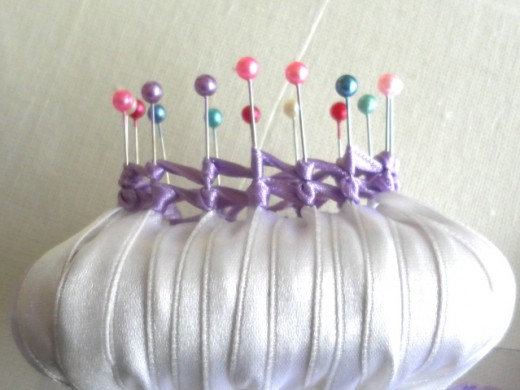 Notice the pins have two layers of purple ribbon