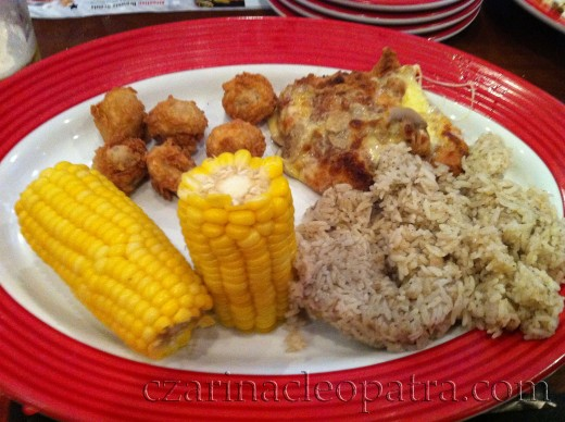 Brown rice, corn, fried meat balls, and baked cheesy meaty thing with mushroom