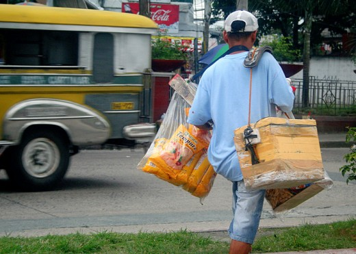 variety is the name of the game for this hawker. He carries frozen goodies inside his styro box