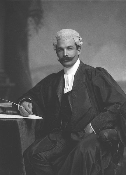 lawyer dressed in barrister's robes and wig