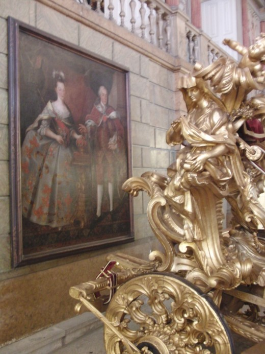 The painting behind a coach made specially for a papal visit.