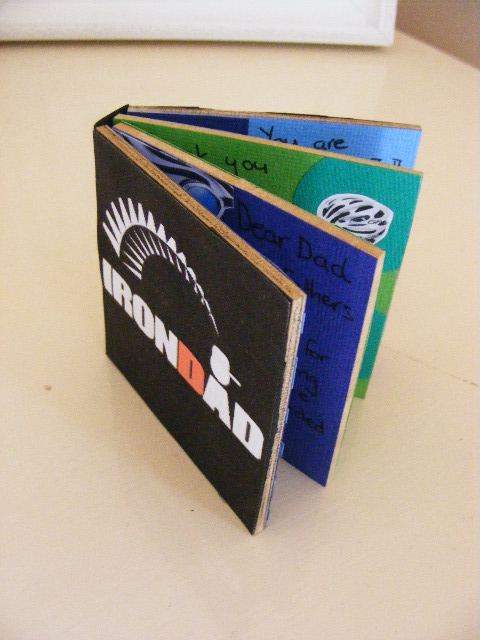 A card made out of board for Fathers Day for a triathlete dad