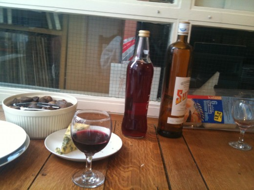 A glass of red wine, and some other drinks for the mood.