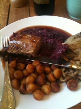 The rack of lamb and red cabbage and shallots and new potatoes