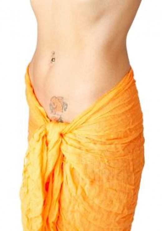 love goddess tattoo on shoulder. koi fish tattoo on lower belly