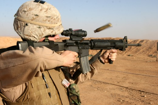 A U.S Marine firing the M16A4 equipped with an Advanced Combat Optical Gunsight  and vertical foregrip