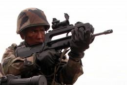 A French infantry soldier with the Fusil d'Assaut de la Manufacture d'Armes de Saint-Étienne (FAMAS)