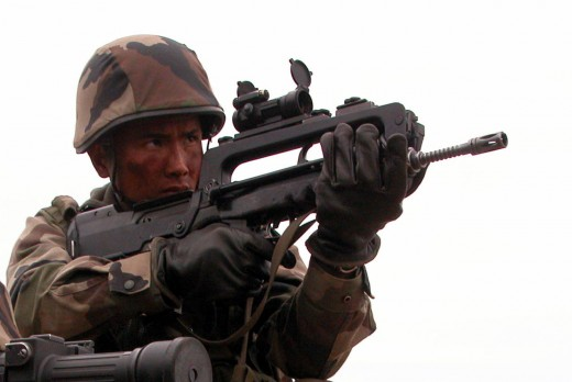A French infantry soldier with the Fusil d'Assaut de la Manufacture d'Armes de Saint-Étienne (FAMAS)