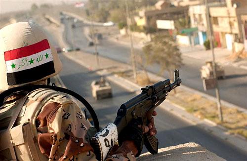 An Iraqi soldier holding the Avtomat Kalashnikova (AK-47)