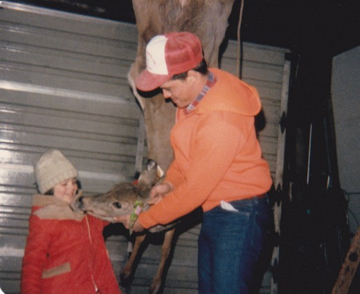 Childhood is about family. My family was big into opening weekend of deer hunting. My Dad was trying to convince me to give the deer a kiss!