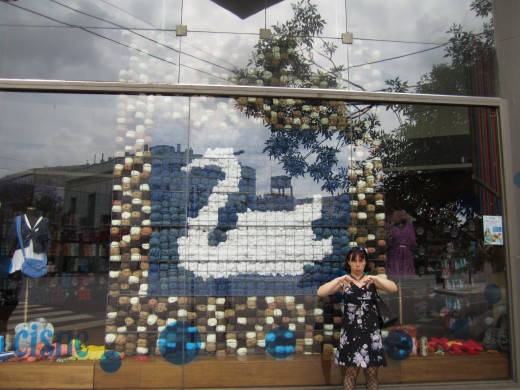 Author, standing in front of closed yarn store in Buenos Aires yarn district
