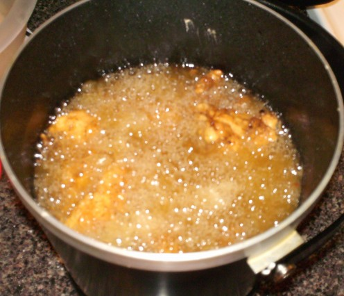 Chicken strips in deep fryer.