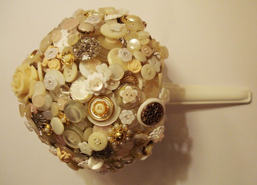 "I remember being fascinated by my grandmother's button collection, as a child. Looking back, I still want to just eat them! Create your ""Something old"" with buttons that have been passed down a generation or two."