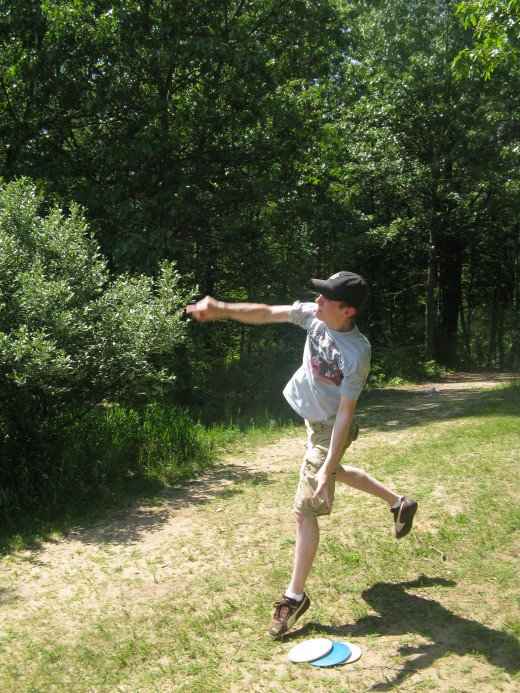 Disc golf drive photo - This would have been better if I had captured the disc coming straight off his hand.  Timing is important!