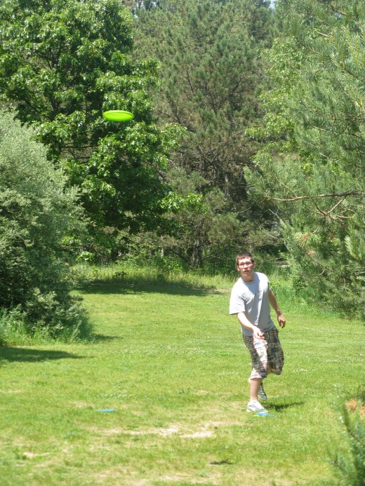 Disc golf drive photo - I love shots that have the disc flying through the air.