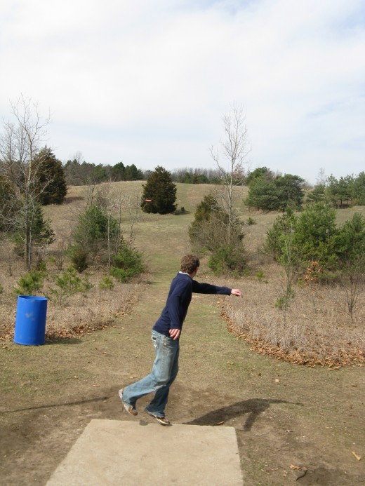 Disc golf drive photo - This is an example of a unique landscape shot.