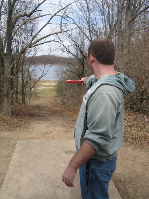 Disc golf drive photo - This is one of my favorite holes on any course I've played.  It's all downhill about 400 feet, meaning you can throw a mid range disc nearly all the way to the basket.
