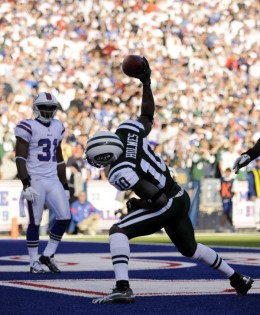 New York Jets' Santonio Holmes (10) celebrates his touch down in front of Buffalo Bills' Jairus Byrd (31) during the second half of an NFL football game in Orchard Park, N.Y., Sunday, Nov. 6, 2011. The Jets won 27-11. (AP Photo/Gary Wiepert)