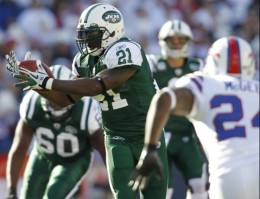 New York Jets' LaDainian Tomlinson (21) catches a pass during the second quarter of an NFL football game against the Buffalo Bills in Orchard Park, N.Y., Sunday, Nov. 6, 2011. (AP Photo/Derek Gee)