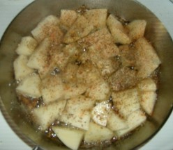 Potatoes with seasoning in oil.