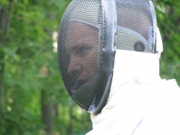 My son in fencing gear - practicing in the backyard.