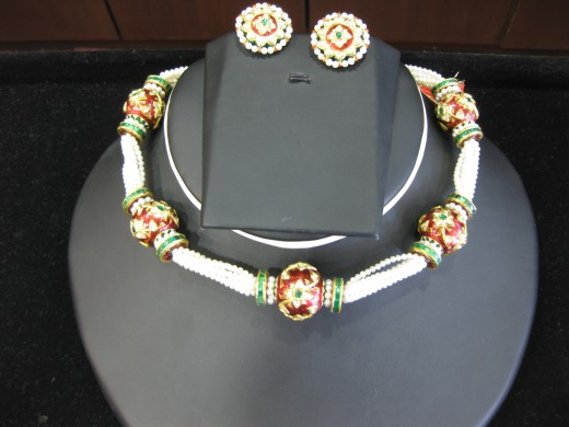 Kundan - Meeena Necklace with tops pair. Tiny pearls strings are beautifying the set.