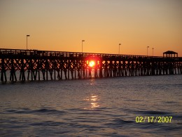 PICTURE OF SUNRISE AT MYRTLE BEACH THROUGH A PIER