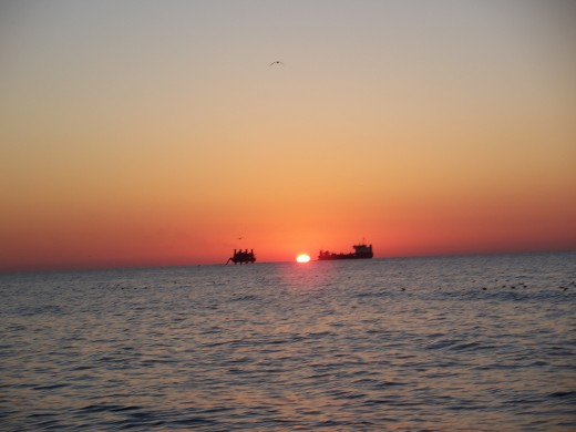 SUNRISE AT MYRTLE BEACH THROUGH A DREDGE BOAT