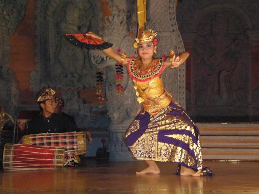 In Legong Balinese Dance, musicians sit in the stage and play live music while the dancers perform. Ubud, Bali, Indonesia.