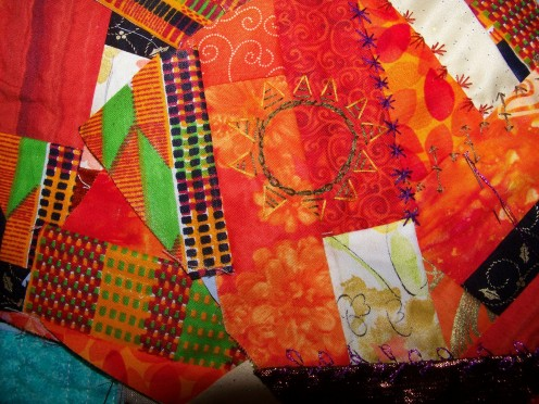 This unfinished crazy quilt, named my African Prince, uses a variety of African and American fabrics, and African motifs.
