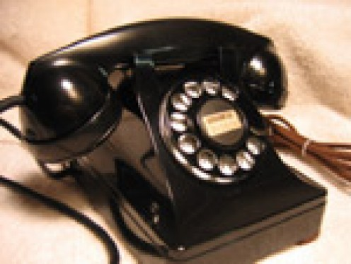 """THIS IS NOT THE FIRST PHONE. THE VERY FIRST, SO-CALLED """"MODERN"""" PHONE WAS A WALL PHONE THAT YOU HAD TO CRANK TO GET THE OPERATOR TO GET YOU A NUMBER."""