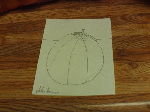 In this phase of the sketch I have finished sketching in the sections of the pumpkin.