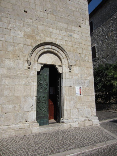 The right entrance door of the church of St. Mary of the Assumption in Amaseno, Italy