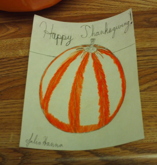 I am beginning to color in the dark orange parts of the pumpkin.
