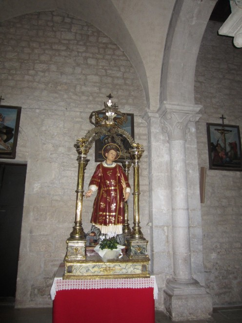 The statue of San Lorenzo (St. Lawrence) in the church of St. Mary of the Assumption, Amaseno, Italy
