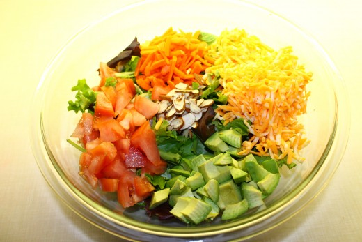 Carrots, cheese, avocado, tomatoes and shaved almonds on top of the spring mix