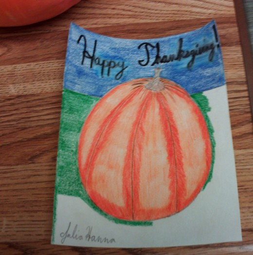 Here I am coloring in the background where the pumpkin is sitting.