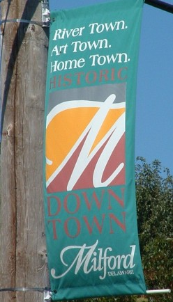 Milford, DE, is proud to be known as a river town, art town, home town with a historic down town. Flags with this inscription grace the historic streets and riverwalk.